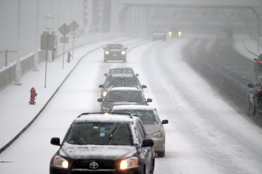 Drivers crossed the Fore River Bridge in Quincy as the snow started.